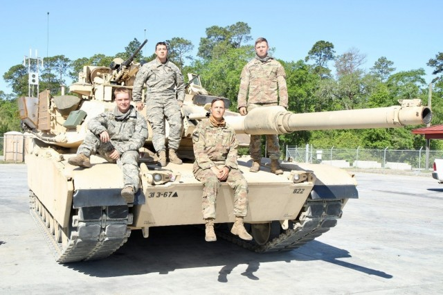 A crew with Bravo Company, 3rd Combined Arms Battalion, 67th Armor Regiment, 2nd Armored Brigade Combat Team, 3rd Infantry Division, won the 2nd ABCT Tank competition April 18 at Fort Stewart, Ga. The competition was used to determine the crew that will represent 3rd ID at this year's Sullivan Cup scheduled for April 29 to May 4 at Fort Benning, Ga. Crews were assessed on their ability to accomplish eight tasks. This crew  placed first with a score of 1567.5 points out of a possible 2000. (U.S. Army photo by Spc. Leo Jenkins/ released)