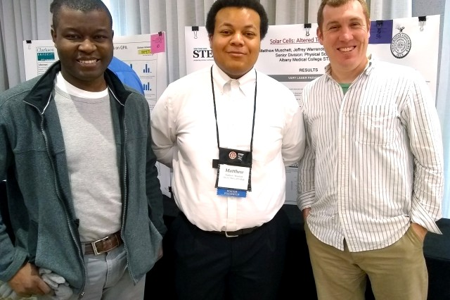 Schenectady High School senior Matthew Muschett, center, took first place for his research in solar cells.  In preparation to his competition, Matthew conducted an internship with ARDEC-Benet Laboratory mentors Dr. Jeffrey Warrender, right, and Dr. Thierry Tsafack.