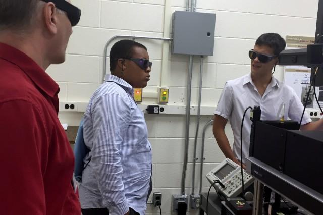 Schenectady High School senior Matthew Muschett, center, with ARDEC-Benet mentors Dr. Quentin Hudspeth, left, and Dr. Philippe Chow.