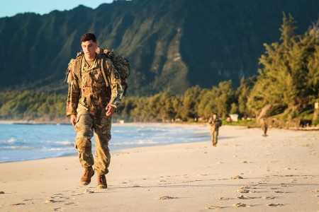Soldiers with the 94th Army Air and Missile Defense Command, perform a tactical beach road march on Bellows Air Force Station, Waimanalo, Hawaii, March 27, 2018. The week long competition tested the Soldiers during individual and team competitive events.
