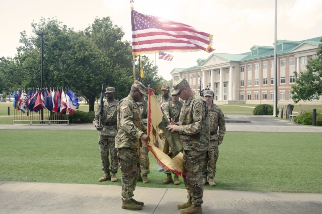 Lt. Col. Anthony Hughley, commander, 904th Contracting Battalion, and Command Sgt. Maj. Barrett S. Taylor, uncase the unit's colors during an uncasing ceremony at Marne Gardens in Fort Stewart, April 19, 2018. The unit was operationally aligned with the 3rd Infantry Division's headquarters in Bagram Airfield, located in northern Afghanistan during a nine-month long deployment in support of Operation Resolute Support. (U.S. Army photo by Staff Sgt. Sierra A. Melendez, 50th Public Affairs Detachment)