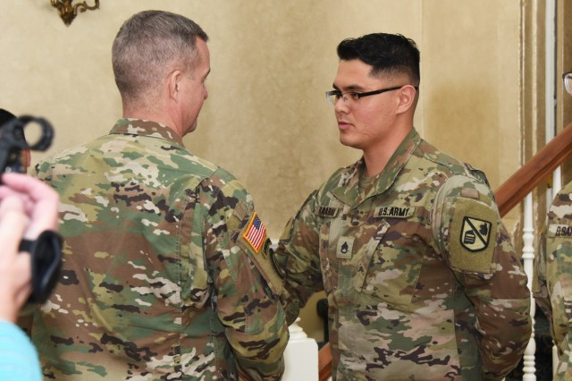 Staff Sgt. Alex Rababah (right), an Arabic Military Language Instructor at the Defense Language Institute Foreign Language Center, Presidio of Monterey, shakes hands with Command Sgt. Maj. David Turnbull, the command sergeant major of the U.S. Army Combined Arms Center at Fort Leavenworth, Kansas, after being recognized during a NCO professional development session Feb. 23. (U.S. Army photo by Patrick Bray/Released)