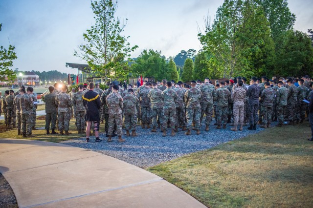 COLUMBUS, Ga. (April 25, 2018) -- A crowd of Soldiers attend the ANZAC Day observance. To commemorate Australian and New Zealander military members who died in service over the past 103 years, Soldiers and Family members gathered at the 173rd Airborne Brigade Sky Soldier Memorial at the National Infantry Museum in Columbus, Georgia, before dawn April 25. The sunrise service, organized and run by the Australian Army Contingent on assignment at the Maneuver Center of Excellence and Fort Benning, was in observance of ANZAC Day, the anniversary of  the 1915 landing of Australia and New Zealand Army Corps soldiers at Gallipoli in what was then the Ottoman Empire and is now Turkey. (U.S. Army photo by Patrick Albright, Maneuver Center of Excellence, Fort Benning Public Affairs)