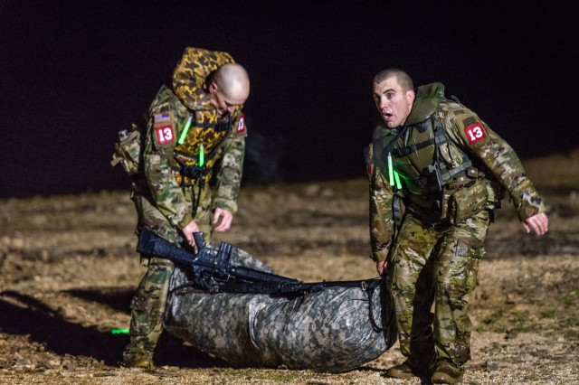 Sgt. 1st Class Robert Clark (left) and Capt. Rudy Chelednik (right), 3rd Brigade Combat Team, 101st Airborne Division, compete in the U.S. Army's Best Sapper Competition at Fort Leonard Wood, Mo., April 18, 2018. Their team ultimately went on to win first place in the competition over 39 other teams from across the Army.