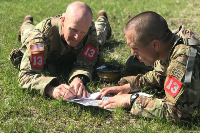 Sgt. 1st Class Robert Clark (left) and Capt. Rudy Chelednik (right), 3rd Brigade Combat Team, 101st Airborne Division, plot their next foot movement during the U.S. Army's Best Sapper Competition at Fort Leonard Wood, Mo., April 18, 2018. Their team ultimately went on to win first place in the competition over 39 other teams from across the Army.