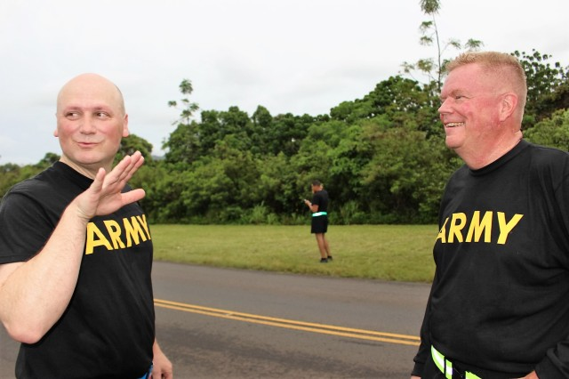 Col. Anthony Aquino, 599th deputy commander for mobilization, speaks to Lt. Col. James Congrove, 599th operations IMA during the APFT on Wheeler Army Airfield, Hawaii, on April 20.