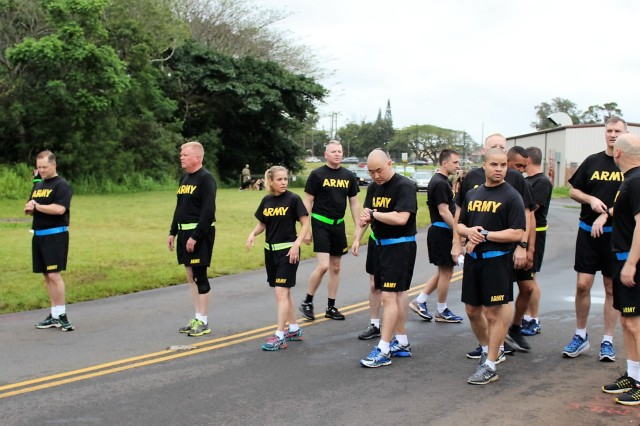 599th IMAs get ready for the 2-mile run portion of their APFT on April 20 at Wheeler Army Airfield, Hawaii.