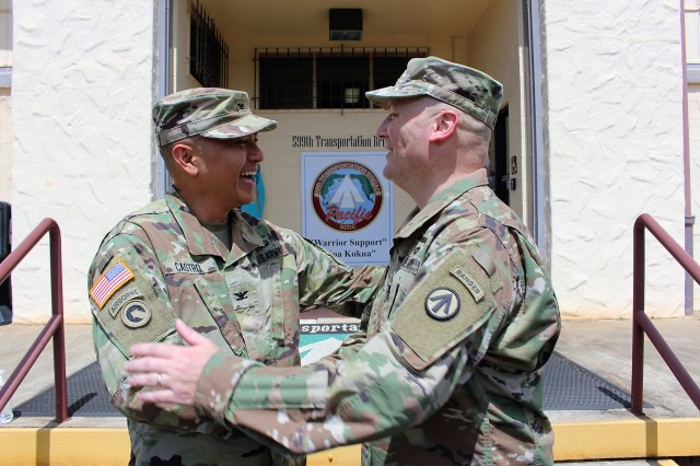 Col. Frazariel Castro, 599th commander, speaks with Col. Anthony Aquino, 599th deputy commander for mobilization, at brigade headquarters on April 18.