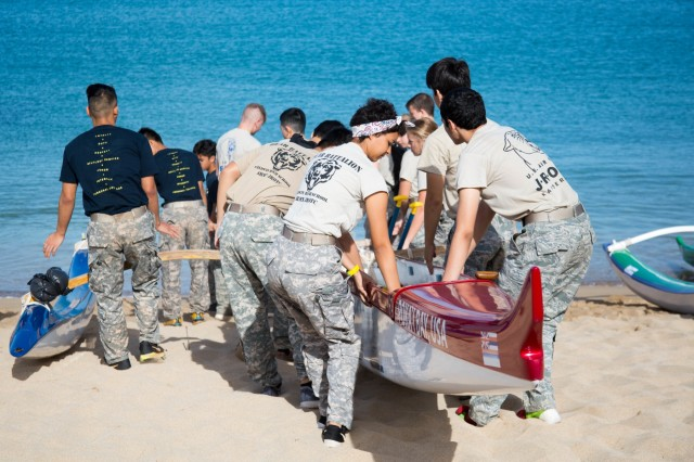 """Cadets from Oahu's Junior Reserve Officers Training Corps launch a seafaring canoe at Pililaau Army Recreation Center, Hawaii April 21, 2018 during the 13th Annual Waianae Adventure Challenge. This event is a multi-day team physical fitness challenge to hone their skills of leadership and camaraderie. """"They're learning the importance of being in charge and setting the pace for everything that the team does,"""" said Staff Sgt. Keith Vinson, a Soldier with B Company, 1st Battalion, 27th Infantry Regiment, 2nd Infantry Brigade Combat Team, 25th Infantry Division. Soldiers from 2IBCT, 25ID helped grade, coach and cheer on these young adults. (U.S. Army Photo by 1st Lt. Ryan Debooy)"""
