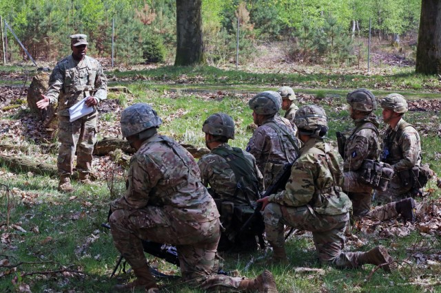 U.S. Army Sgt. Aaron Ward, assigned to Bravo Company, 44th Expeditionary Signal Battalion, 2nd Theater Signal Brigade, instructs U.S. and British Army Soldiers assigned to the 250th Signal Squadron, Queen's Gurkha Signals, on react to contact battle drill during exercise Stoney Run, April 23, 2018 in the Sennelager Training Area, Germany. Stoney Run is an annual U.S.-U.K. signal exercise designed to test and validate communications and network capabilities, and enhance interoperability and partner capacity between the two NATO allies.