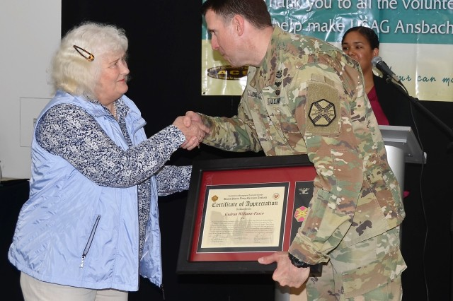 Gudrun Williams-Fusco helped the Ansbach Chapter of the American Red Cross with 1,200 hours throughout the year. She was awarded the Commander's Certificate of Appreciation at the USAG Ansbach Volunteer Recognition April 24, 2018 (U.S. Army photo by Bianca Sowders, USAG Ansbach Public Affairs Office)