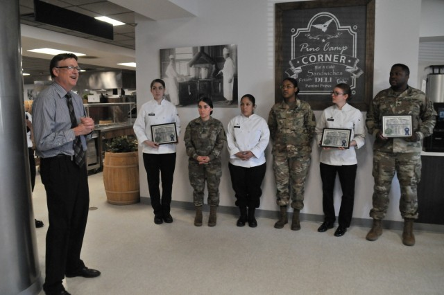 Jim Miller, Fort Drum Environmental Division chief, thanks the culinary specialists from all four of the installation dining facilities for participating in the first Earth Day Cake Bake-Off. The team from 2nd Brigade Combat Team's Commando Café won the inaugural competition.
