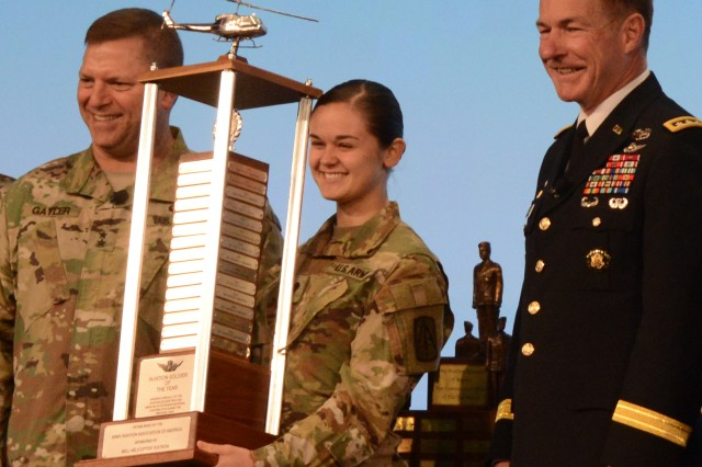 Spc. Madeleine R. Rampona receives the Army Aviation Soldier of the Year award, at the Army Aviation Association of America-hosted 2018 Army Aviation Mission Solutions Summit in Nashville, Tenn., April 26, 2018. Presenting the award is Vice Chief of Staff of the Army Gen. James C. McConville. Maj. Gen. William K. Gayler, commander, U.S. Army Aviation Center of Excellence (left) participated in the presentation.