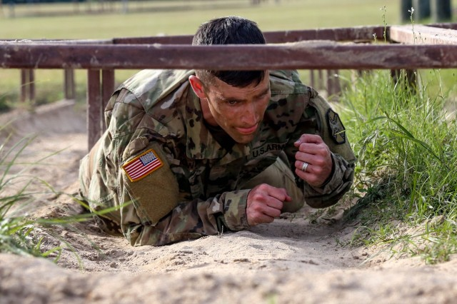 Sgt. Justin Howard propels himself through the obstacle course during the Best Warrior Competition at Camp Bullis.