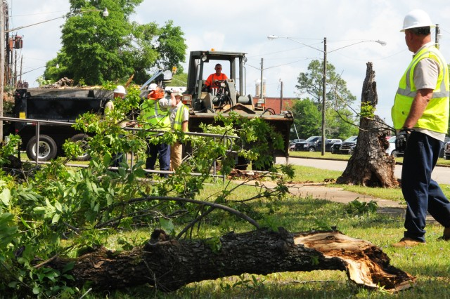 Crews work to remove debris April 23 from areas affected by the tornado that hit Fort Rucker April 22.