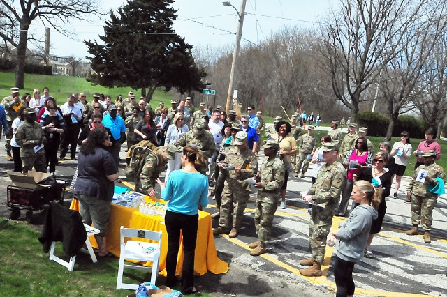 About 70 people participate in the walk April 26 at Rock Island Arsenal, Illinois. Shown are people gathering at a stop to receive information on SAAPM and items offered to them. (Photo by Jon Micheal Connor, ASC Public Affairs)