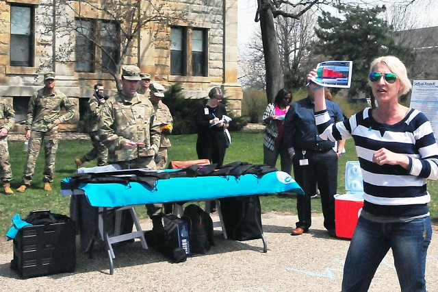 Meghan McAndrew, SHARP program manager, RIA and U.S. Army Sustainment Command, gives out information at the end of the walk in Constitution Square. (Photo by Jon Micheal Connor, ASC Public Affairs)