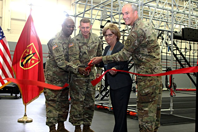 (From left) Command Sgt. Maj Carl Fagan, FCoE and Fort Sill CSM; Maj. Gen. Wilson A. Shoffner, FCoE and Fort Sill commanding general; Brenda Spencer-Ragland, Family and Morale, Welfare and Recreation director; and Col. Samuel Curtis, Fort Sill Garrison commander; officiate the reopening of Goldner Fitness Center with a ribbon cutting ceremony April 17, 2018. The gym will tailor to functional fitness-like equipment and workouts.
