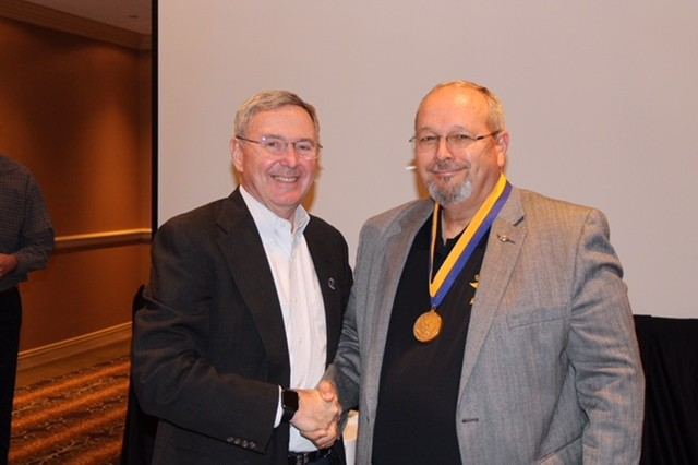 Dr. Bill Lewis (right), director of the Aviation Development Directorate of AMRDEC, was inducted into the Gold Honorable order of St. Michael by AAAA President, BG (Ret.) Steve Mundt during a pre-Summit meeting in Nashville. The next day, Lewis received the John P. Cribbins Department of the Army Civilian of the Year award.