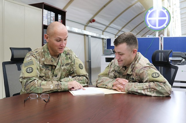 Staff Sgt. Michael McMillan, 35th Infantry Division behavioral health noncommissioned officer in charge, confers with Capt. Trever Patton, 35th Inf. Div. psychologist, on Oct. 30, 2017, in Kuwait. Embedded behavioral health teams are a key part of providing easy access to care for service members.