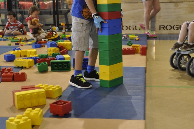 A little boy plays with LEGOs during Kids' Day April 21, 2018, at the Community Activity Center on Chièvres Air Base, Belgium.