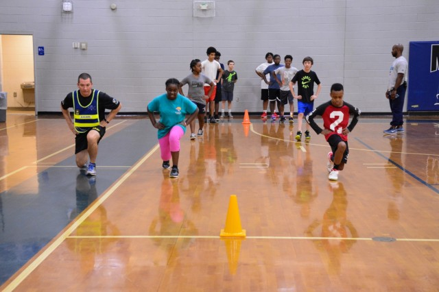Sgt. 1st Class Travis Kelbaugh, a drill sergeant with Bravo Company, 1st Battalion, 46th Infantry Regiment, at Fort Benning, Georgia, participates in a physical fitness education class April 26, 2018, at Midland Middle School in Columbus, Georgia. The event was a part of Fort Benning's Partners in Education program, which brings military units and schools in the local area together. (Photo by Megan Garcia, Maneuver Center of Excellence, Fort Benning Public Affairs)