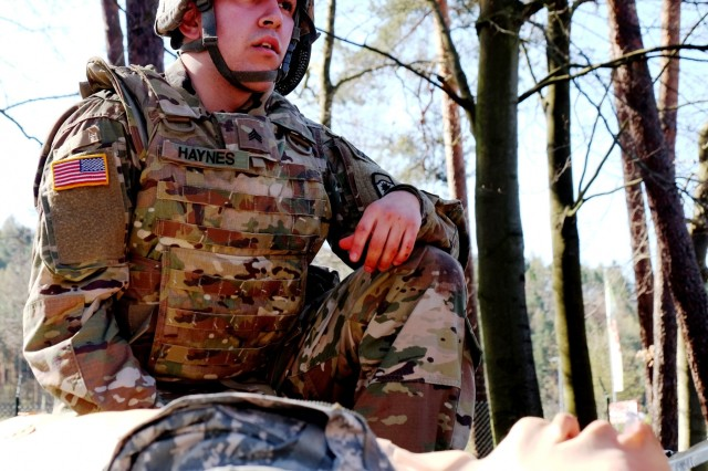Sgt.William Haynes Jr., from the 773rd Civil Support Team 7th Mission Support Command, United States Army Reserve, radios in a simulated casualty evacuation during this year´s annual  Best Warrior Competition at Daenner Kaserne,  April 15, 2018.
