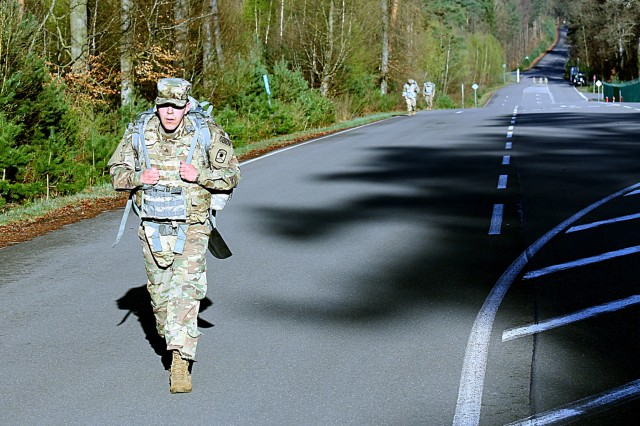 Sgt. William Haynes, of the 773rd Civil Support Team, walks as other competitiors trail behind him during the ruck march of the 7th Mission Support Command's Best Warrior Competition April 16, 2018 on Daenner Kaserne in Kaiserslautern, Germany.