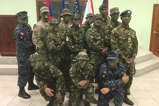 Louisiana National Guard Kenrick Cormier, second from left, back row, stands with his fellow graduates from the Belize Defence Force's Jungle Warfare Instructor Course in Belize. Cormier was the first Guardsman to participate in the course.