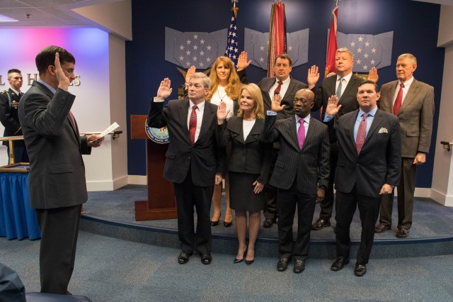 The Honorable (Dr.) Mark T. Esper, Secretary of the Army, swears in eight new Civilian Aides to the Secretary of the Army during a recent investiture ceremony here in the Pentagon, Washington, D.C. Back row, left to right: Susan Green, Timothy Jones, Eric Mansfield, Don Tyre. Front row, left to right:     Michael Hockley, Tammy Carnrike, Charles Rice, Kevin Offel.