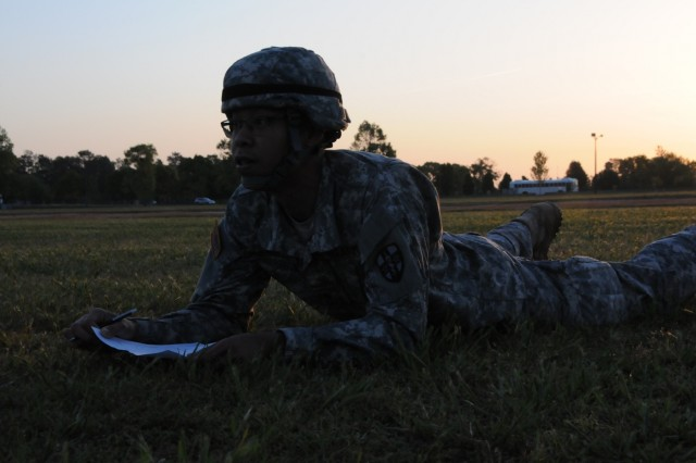 Spc. Vongpheth Sophouthalangsy, assigned to 7236th Medical Support Unit in Fort Benning, Georgia, fills out a SPOT report while providing perimeter security during stand-to on April 13th.  Sophouthalangsy is one of nine Soldiers from Army Reserve Medical Command who arrived on April 11th, prepared to compete in the command-level Best Warrior Competition for 2018 held April 11-15, at the home of the U.S. Cyber Center of Excellence - Fort Gordon, Georgia. The Best Warrior Competition recognizes Soldiers who demonstrate commitment to the Army values, embody the Warrior Ethos and represent the force of the future.