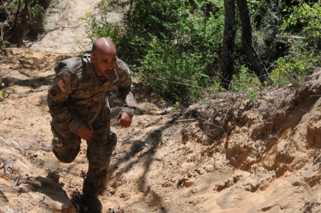 Spc. Christopher Polk, assigned to 7377th Blood Detachment in Marana, Arizona, competes on an obstacle course on April 12th. Polk is one of nine Soldiers from Army Reserve Medical Command who arrived on April 11th, prepared to compete in the command-level Best Warrior Competition for 2018 held April 11-15, at the home of the U.S. Cyber Center of Excellence - Fort Gordon, Georgia. The Best Warrior Competition recognizes Soldiers who demonstrate commitment to the Army values, embody the Warrior Ethos and represent the force of the future.
