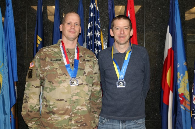 Capt. Ryan Hignight, U.S. Army Corps of Engineers, Omaha District, Public Affairs Officer, and Eric Vokt, USACE Omaha District, Deputy Chief of Contracting, each wear their 2018 Boston Athletic Association medal April 20. Hignight completed the Tough Ruck in Concord, Mass., and Vokt completed the Boston Marathon. Both events were conducted the second weekend of April.