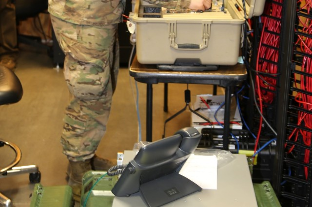 A Soldier from the XVIII Airborne Corps Headquarters works on the small form factor variant of Commercial Coalition Equipment (CCE), with the new CCE-large seen bottom, during the Joint Multinational Warfighting Exercise 18-4 at Fort Bragg, North Carolina, on April 5, 2018. The new CCE-Large provides the same secure tactical network access for the coalition or commercial networks as the original small form factor variant, but it supports larger division and corps-size elements more effectively.