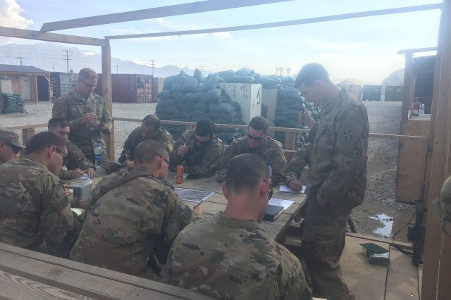First Lt. Zackary Sostak, assigned to 3rd Platoon, Dagger Company, 2nd Battalion, 12th Infantry Regiment, 2nd Infantry Brigade Combat Team, 4th Infantry Division, delivers an operations order to his squad and team leader, March 29, 2018, in Kandahar, Afghanistan. (U.S. Army photo by 1st Lt. Matthew Walker/2nd Bn., 12th Inf. Reg. UPAR)