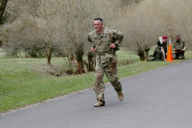 U.S. Army 1st Sgt. Derek Bassett, Headquarters and Headquarters Company senior enlisted adviser assigned to the Joint Multinational Readiness Center, participates in the ruck march portion of the German Armed Forces Badge for Military Proficiency (GAFB) event in the Hohenfels Training Area, Hohenfels, Germany, April 12, 2018. Eighteen U.S. Army Soldiers assigned to the Joint Multinational Readiness Center participated in the GAFB event to earn the coveted badge.