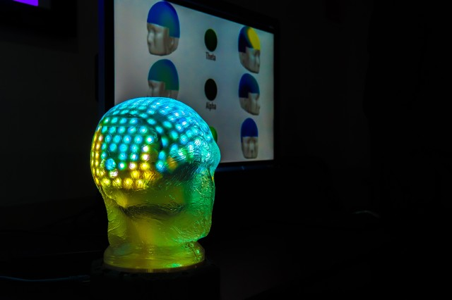Pulsating intense colors, a visualization tool developed by the U.S. Army Research Laboratory indicates how well two people's brains are synchronized during a real-world experiment.