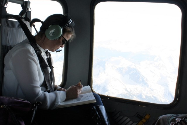 Analyst Julie Kastrati does some studying on the helicopter flight back to Camp Bondsteel, Kosovo, after visiting Camp Butmir, Bosnia and Herzegovina, April 24.