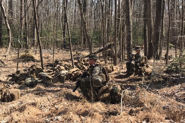 U.S. Marines with Surveillance and Target Acquisition Platoon and Company C, Weapons Platoon, 25th Marine Regiment, 4th Marine Division, and Marine Forces Reserve, assault targets from support-by-fire positions during a mission rehearsal exercise on U.S. Army Garrison, Fort A.P. Hill, Va., on April 6, 2018.