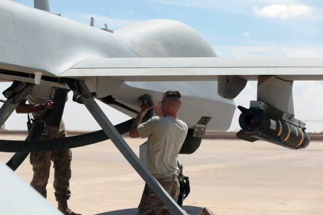 Undisclosed Location - U.S. Army Spc. Robert Taggart, a Soldier assigned to Company B, 229th Aviation Regiment, 449th Combat Aviation Brigade refuels a MQ-1C Gray Eagle Unmanned Aircraft System after conducting flight operations March 31, 2018. Company B is currently deployed in the Southeast Asia region utilizing the MQ-1C Gray Eagle Unmanned Aircraft Systems that conducts reconnaissance and attack operations enabling U.S., Coalition and partner nations to defeat and destroy ISIS in support of Operation Inherent Resolve. (U.S. Army photo by Spc Devin Fleming, 449th Combat Aviation Brigade)