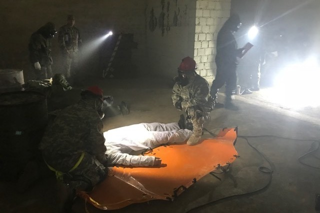 Texas Army National Guard engineers from the 836h Engineer Company, 136th Maneuver Enhancement Brigade, work alongside Soldiers from the Indiana National Guard, the Czech Republic and Slovakia in support of Operation Toxic Lance, a search and rescue exercise involving a chemical warfare scenario, April 12th -- 23rd, 2018, at Training Area Lest in central Slovakia. The Soldiers were brought together as part of the National Guard Bureau's State Partnership Program that focuses on building interoperability and strengthening international relationships through military-to-military exchanges.