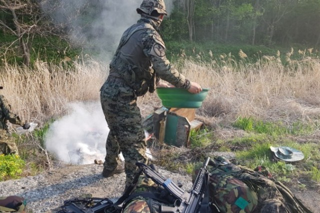 Soldiers from the Republic of Korea Special Forces douse the tractor and extinguish the fire which severely injured a local Korean farmer April 25. The ROKSF soldiers and Soldiers from 1st Special Forces Group (Airborne) were participating in partnered training when they were flagged down to render real world emergency medical care, saving the elderly farmer's life.