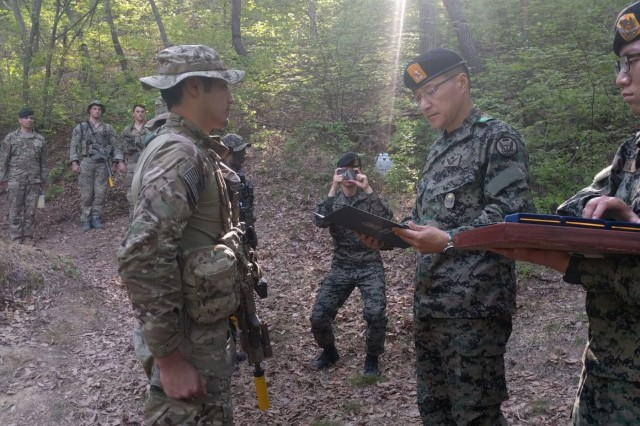 A Republic of Korea Special Warfare Command general presents citations to Soldiers from the 1st Special Forces Group (Airborne) after his efforts resulting in saving the life of an elderly local Korean farmer April 25, in Yeongcheong, North Gyeongsang Province. The 1st SFG (A) Soldiers were training with their partners in the ROKSF when they stopped to render emergency care to an elderly farmer who had incurred life-threatening injuries when his tractor malfunctioned and caught on fire.