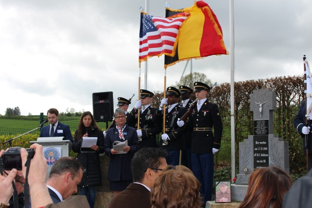 Landstuhl Regional Medical Center Color Guard participate in a ceremony April 28, 2018 in Wereth, Belgium honoring 11 Soldiers who were massacred during the early stages of the Battle of the Bulge in World War II. LRMC Color Guard includes: Staff Sgt. Darron Elder Staff Sgt. Victor Hyatt Sgt. Demon Lawrence Sgt. Isaac Findley Pvt. 1st Class Matthew Kinser Led by Sgt. 1st Class Cheryl Mays