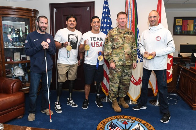 U.S. Paralympians and veterans (from left) former Navy PO1 Kevin Burton, former Marine Corps. Gunnery Sgt. Ralph DeQuebec, former Army Staff Sgt. Rico Roman, Gen. James McConville, Army Vice Chief of Staff and former Army Spc. Andy Soule met at the Pentagon April 24.