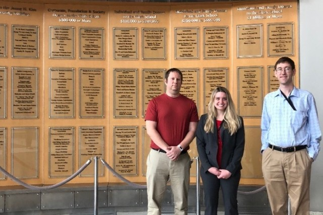 U.S. Army Research Laboratory student intern Sabrina Curtis stands with ARL mentors, Drs. Nathan Lazarus and Randy Tompkins, at her thesis defense at the University of Maryland in College Park.