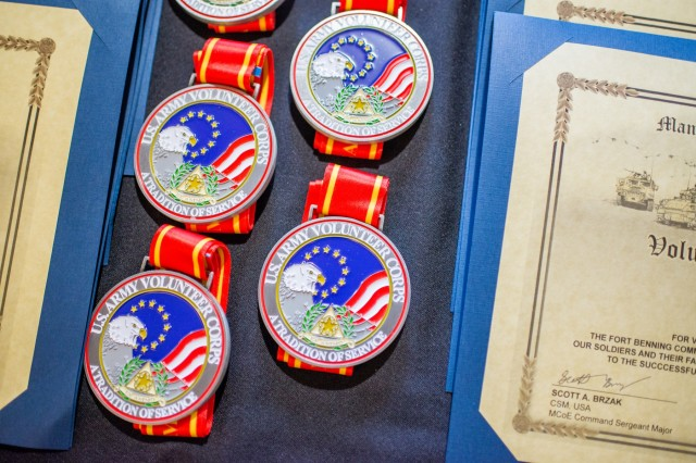 FORT BENNING, Ga. (May 1, 2018) - Medallions and certificates are on a table to be presented to volunteers at the Maneuver Center of Excellence and Fort Benning. More than 70 Soldiers, retirees, Family members and civilians were recognized at the 2018 Volunteer Awards Ceremony at the Benning Club at Fort Benning, Georgia, April 26. Volunteer of Excellence Awards were presented to individuals who volunteered at least 500 hours and to organizations that have provided distinguished volunteer service in 2017. (U.S. Army photo by Patrick Albright, Maneuver Center of Excellence, Fort Benning Public Affairs / RELEASED)