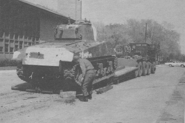 Livonia traffic was re-routed while the Sherman was hauled aboard the tank transporter.  The rig and its World War II cargo spent the night in Livonia.