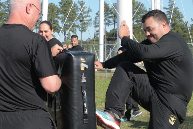 Army Capt. Mark Dutton (left) and Army Sgt. Brian Hardin (right), assigned to the United States Property and Fiscal Office for North Carolina, practice defensive techniques at Camp Butner Training Site in Stem, North Carolina, April 17, 2018. Operation Balanced Soldier incorporates many Army Combative training techniques such as kicking, punching and blocking.