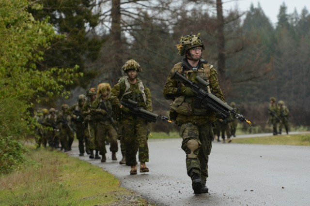 Soldiers assigned to the 39th Canadian Brigade Group proceed along a road march toward the Leschi Village training area at Joint Base Lewis-McChord, Washington, April 28, 2018. Soldiers from the Oregon National Guard and Canada took part in four-days of training as part of Exercise Cougar Rage, April 26-29.